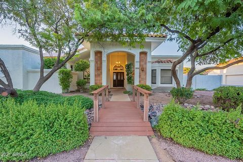 You will LOVE this wonderful home in The Groves of North East Mesa. This Beautiful 4 Bedroom, 3 Bath custom home with a flex space and formal room sits on a N/S Exposure oversized lot with all mature landscaping. Nearly every inch of this 2800SF home...