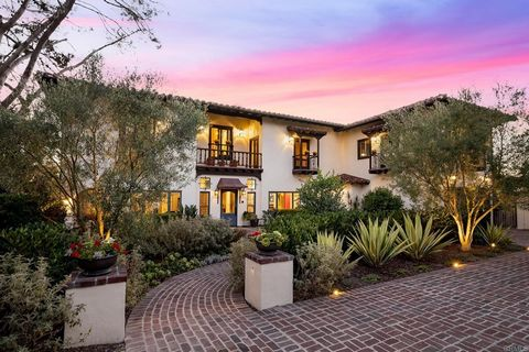 Perched on the highest crest of Olde Del Mar, this singular home is as rich in its extraordinary details, artisanal appointments, construction and finishes as in its heritage of inspired Spanish Colonial Revival design. The California dream meets the...