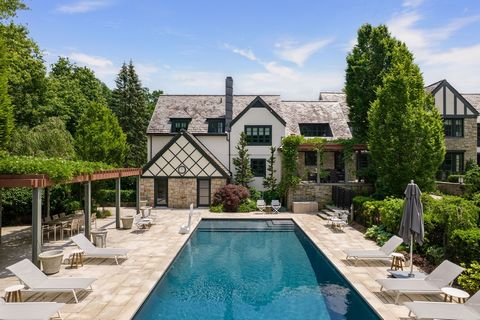 This captivating stone and slate English Manor create an uncompromisingly luxurious estate and offer 3.44 level acres of beautifully designed park-like gardens. Pool & cabana, tennis/sports court with tennis shed, dining terraces, vine-covered pergol...