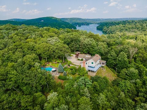 On top of the world! Incredible, distant views stretch all the way to the Hudson River and West Point. This amazing hilltop home offers absolute privacy and serenity high atop coveted Mead Street within the Waccabuc Historic District. Privately sited...