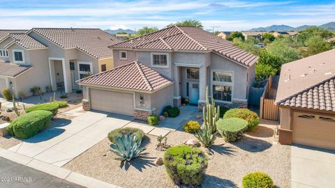 Welcome to this fabulous home where you can fully enjoy the Arizona lifestyle. It's tucked in the gated Dove Valley Ranch and golf community. The popular floor plan has 4 bedrooms/3 baths (or 3 plus den) to accommodate all your needs. Lovingly mainta...