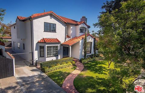 Rare 4000 sq ft meticulous Spanish newer construction home with 5 beds + 4.5 baths, private grassy yard, spacious rooms, and high ceilings on quiet tree-lined Vista St in Miracle Mile HPOZ neighborhood. Handsome curb appeal, wide driveway and 2 car g...