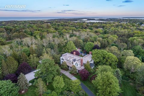 Enjoy the Cape Cod lifestyle in a magically self-contained property w/trails, lawns, gardens, on-site tennis court, sand volleyball court, basketball hoop, heated gunite pool, spa, pool house, state-of-the-art outdoor kitchen, pond, meditation area &...