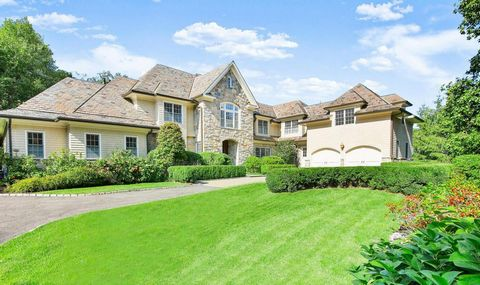 Sun-filled stone/shingle country house with slate roof and elegant courtyard on private 1.3 acres manicured acres in Chieftans, one of Greenwich's few gated communities. Two-story entry hall introduces the bright 7,000+ sq ft interior rich in classic...