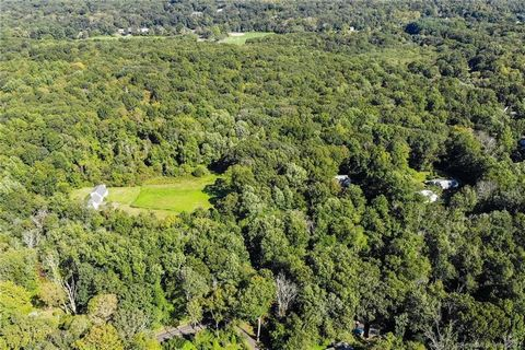 Amazing Opportunity to develop approx. 14+ homes in the extremely desirable shore town of Guilford! Pastoral 28+ acres of beautiful land. The location fronts on Long Hill Road which, unlike much of Guilford, has both Public Water and Natural Gas line...