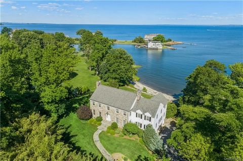 Exquisite custom waterfront Georgian Colonial home built in 2004 set on an elevated location on Rye's premier peninsula with breathtaking views of Long Island Sound across your own private 150-foot-long sandy beach. Designed with traditional elegance...