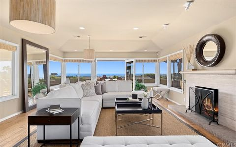 Imagine a life of luxury and elegance in this immaculate Corona del Mar corner-lot residence that takes full advantage of the stunning ocean views on display. Explore the bright interior where expansive windows usher in natural light and glass doors ...