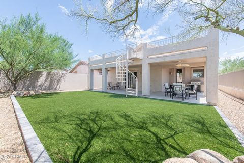Upgraded recently inside and out with wood look flooring, remodeled bathrooms, added lighting, newer AC, and upgraded turf in back. This home truly checks all the boxes. One of the most desirable locations within McDowell Mountain Ranch. This home si...