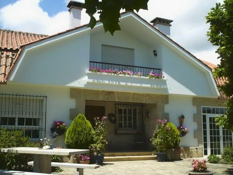 Nr O Rosal, Pontevedra.and#13;and#13;An attractive country villa in a coveted rural location , with outstanding views over its own well maintained mature grounds, vineclad mountains to the North and Portuguese mountains to the South.and#13;House comp...