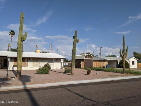 No HOA. Large lot (12,963 SF). RV double gate and RV parking. Workshop and Tuff shed in back yard. This home also has an additional approximately 262 SF Arizona Room and extra room formerly used as an office. Living space is approximately 1080 SF. Bu...