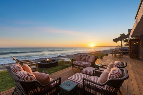Beach Road is a slice of paradise along the California Riviera in Capistrano Beach. This magnificent home defines beachfront living. Located on the sand, atop a double lot which commands the highest elevation on the Road, this masterpiece took its in...