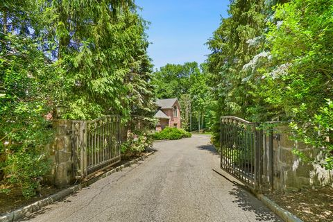 Gated entry leads to custom-built brick seven-bedroom Colonial. Graceful and welcoming, combining elegance and the warmth of home in sought-after Thomas Wright Estate. Enjoy the luxury resort-style living in privacy of your own backyard. Glistening G...
