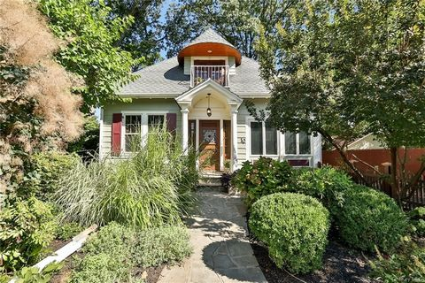 Unique converted carriage house located just blocks from Nyack's urbane downtown. A beautiful established garden enhances the front of this very special home with 4BR's and 3 full baths. Showplace entry with classical columns and sidelight windows fr...