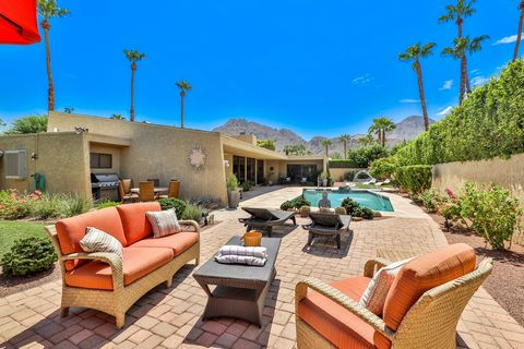 Newly Listed! This stunning late mid century mountain view home has been beautifully remodeled and updated. Located in one of the most prestigious areas of Indian Wells. The home has an impressive circular drive leading to the entrance, soaring ceili...