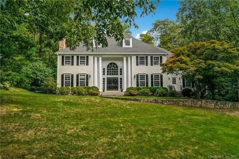 Nestled in the woods at the end of a lovely cul de sac and just minutes from town, this spacious 4 bedroom home greets visitors with a stunning front entryway, including 20 foot ceilings and dual stairways to a second floor balcony. The ground level ...