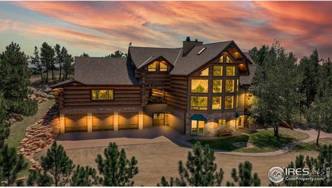 Tucked away on 35 private acres among towering pines, shimmering aspen and moss rock formations, coupled with spectacular views, is this magnificent Log home. Situated in the hills of the Colorado Front Range, Sedona Hills is a gated community that a...
