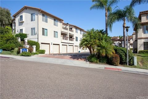 Welcome home to 7418 Altiva Place, where you'll find an immaculate, light and bright, top-floor unit in a superior location within Spyglass Hills! This 2-bedroom, 2-bath condo boasts jaw-dropping views and features its own private balcony which is co...