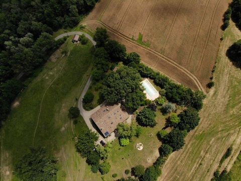 At the end of an almost secret road, the perched property is surrounded by its land and its beautiful garden with trees and flowers. A vegetable garden, a well, a large pond in the woods, the decor is complete. Each of the outbuildings gives a part o...