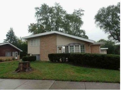 Beautiful updated 3 bedroom 2 bath split level home with a detached garage. (TENANT OCCUPIED). SOLD AS-IS!