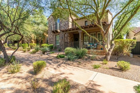 Enjoy the DC Ranch lifestyle in this beautifully appointed Ashton Woods home. Beautiful stone front elevation w/ cozy front porch area. Plantations shutters throughout add to the light & bright feel. Travertine flooring on 1st floor. Spacious formal ...