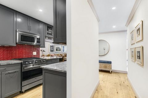 Don't miss this opportunity to own an exceptional, spacious, mint 2 Bedroom, 2 full Bath apartment with an oversized Dining Area, a large Enclosed Sun Room, Washer/Dryer, beautiful light Maple floors throughout and Renovated open Kitchen all in a ful...