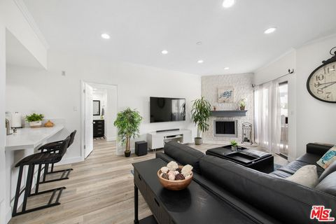 Tastefully updated, top floor, single level 2 bedroom 2 bath condo w/ an open floor plan, new high-end wood vinyl wide plank flooring, fresh paint & new LED recessed lights throughout. Kitchen has white cabinets and S/S appliances including brand new...