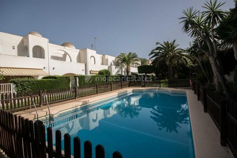 An attractive townhouse on 3 levels for sale on La Jara Urbanisation in Vera Playa, Almeria, Andalusia with beautiful communal gardens and pool. The property is less than 100 metres from the sea, promenade and bicycle lanes. From the street level the...