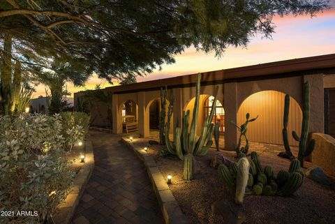Extraordinary territorial resort home in the magical 85254 zip code close to Kierland with incredible shopping, dining, golfing and so much more. No HOA. OWNED SOLAR. This home has been meticulously maintained, loved and upgraded by the homeowners! F...