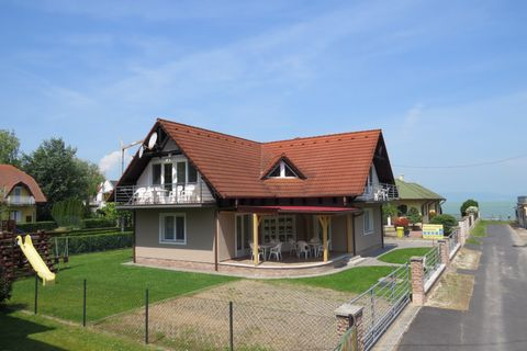 The Beach House is located in thevillageofBalatonlelle, on a dead-end street nearLake Balaton. In this quiet environment you can relax, enjoy the sunshine and take a refreshing dip in the Balaton, which is just 30m away. In the garden there is a slid...