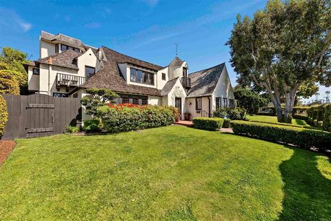 This English Tudor landmark estate is a fixture within La Jolla's historic Beach Barber Tract neighborhood that is widely admired for its architectural beauty, its unusually large corner lot with surrounding gardens, and its coveted location that's j...