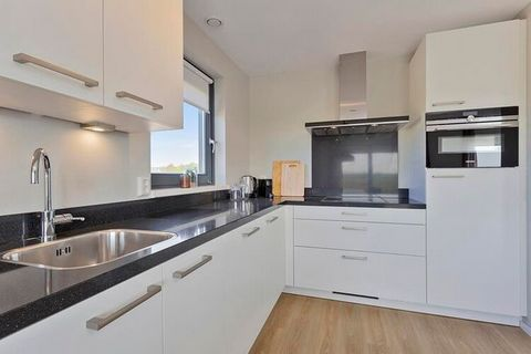 Enjoy a relaxing holiday in this modern holiday home close to Scherpenisse Beach. This home has a pleasant garden where you can stay comfortable with the whole family. The beach is a short walk away and it is ideal for a relaxing afternoon. Scherpeni...