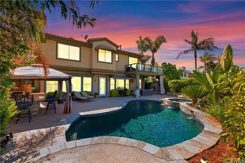 Welcome Home to this Stunning Dove Canyon Estate with over $160,000 of upgrades! This home boasts 5 bedrooms, 5 bathrooms, two large bonus rooms, an executive office and an entertainer's dream backyard! The gorgeous hardscaped entrance and double doo...