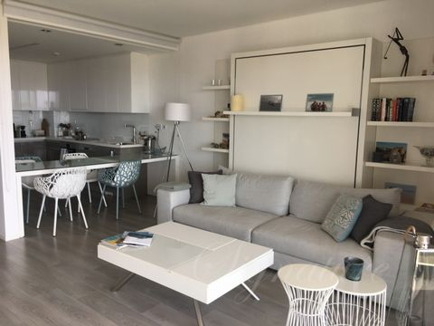 Located in Fuseta. Modern Architecture The sea as your neighbor 1 bed design Apartment , 1 bedroom en suite and 1 extra bathroom with Italian Designed built in bed unit in the living room. Exceptional location, in front of the sea. Walking to the sea...