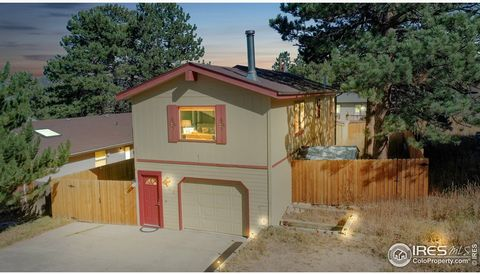 Welcome to this meticulously maintained and beautifully updated home - not to mention one of the most affordable Estes Park homes currently on the market. Main level offers beautiful wood laminate floors throughout, completely updated kitchen which f...