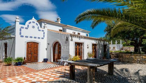 Real estate property for sale with swimming pool and uninterrupted views to the sea and country sidein Moncarapcho in Olhão in the Algarve in Portugal. Character property with luxurious finishes , designed with traditional materials of superior qual...