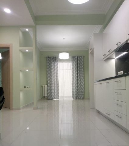 For sale apartment in the center of Athens, Agios Nicolaus. One bedroom apartment, 50 sq.m. and 15 sq.m. terrace, ground floor. Good quality renovation in 2019, installed water warm floors on natural gas, heating, built-in rain shower, high-quality k...