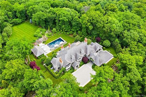In a league of its own. This custom-built Stone Manor, set on one of the highest points in Armonk, offers timeless exterior architecture combined with cutting edge chic transitional interiors. An exciting open concept design provides a grand space, p...