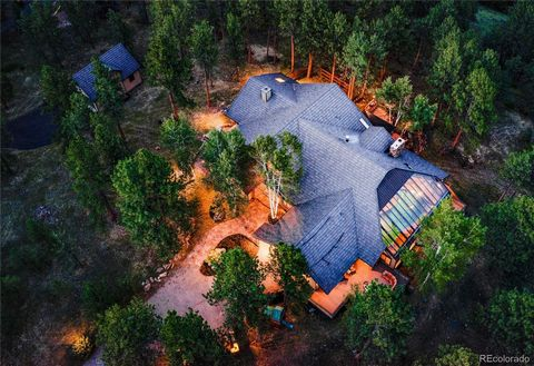Escape the city crowds for the tranquility of mountain living in this custom crafted home offering main floor living in Evergreen's most coveted neighborhood, Soda Creek. Though only 1 mile from I-70 - for a quick jaunt into Denver or to several ski ...