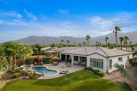 Gorgeous furnished Monarch plan on a 12,623 sq ft. lot with free-form Pebble-Tec pool, cascading spa and impressive rock waterfall. Located in Trilogy La Quinta's 55 plus resort community, this single level home has 1845 sq ft. of interior living spa...
