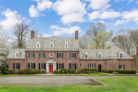 This custom built stately brick 5,170 sq ft (8,750 sq ft by field measure) Georgian Colonial was designed by famed New York architect William McKnight Bowman in the 1930's. Conveniently located on 1.5+ lush private acres surrounded by open space with...