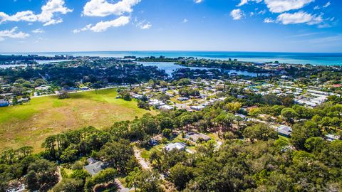 BOATERS DREAM BUILDING LOT CLOSE TO BEACH HALF ACRE SALT-WATER CANAL LOT with One Bridge to the Bay! BRAND NEW DOCK with LIFT In Place and New Aluminum Fence around property. The Canal has been Dredged allowing for easy access year round. This land h...