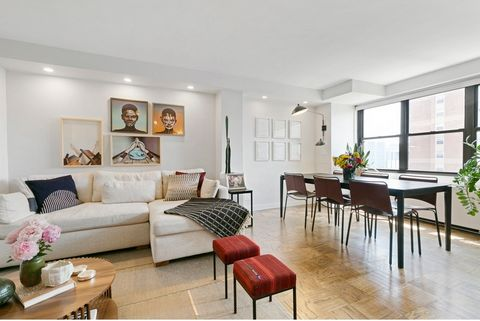 PRICED TO SELL. Rarely available 2-bedroom top-floor, corner penthouse home, showcasing spectacular city views. At approximately 1,010 sq ft., this residence was beautifully and smartly renovated by the owner who is a designer, and featured in Domino...