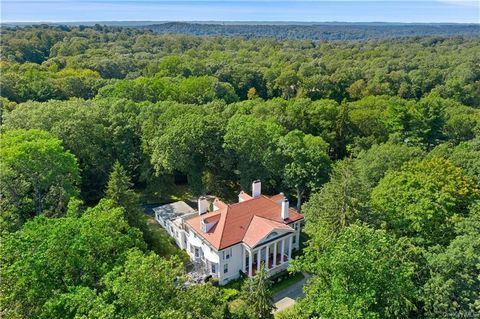 Privacy abounds at this iconic turn-of-the-century, neoclassical Estate, high on a hilltop with a sweeping drive, lakefront freeform pool with waterfall, guest/pool house and carriage house, majestically sited on 8+ acres. Beautifully scaled, the hom...