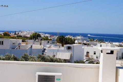 PAROS - PAROKIA: 122sqm APARTMENT FOR SALE. Fully renovated in 2016, with 2 terraces and magnificent sea views in the bay of Parikia. It has 3 bedrooms, living room, kitchen, bathroom, wc 1st floor, airy, fireplace, storage, boiler, night power, priv...