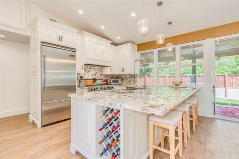 Exquisite Bluffs residence on a quiet cul-de-sac with spectacular Back Bay views (plus a 5-car garage, a $100,000+ conversion). This absolutely meticulous property has been completely rebuilt with style, taste and sophistication. The two bedroom + of...