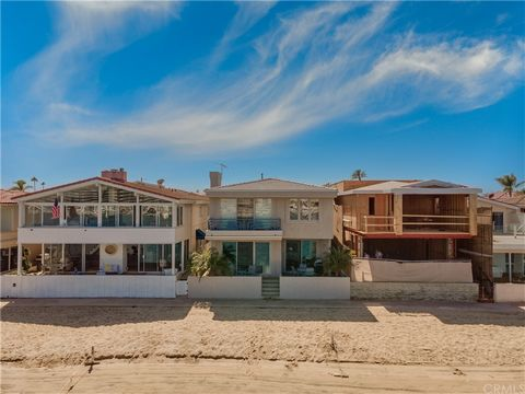 BAY FRONT ON LIDO ISLE. Here's an opportunity to remodel a residence in a truly special waterfront locale. Located on an oversized parcel on the bay on Lido Isle, with a sandy beach at your feet, life does not get much better. Enjoy the constantly ch...