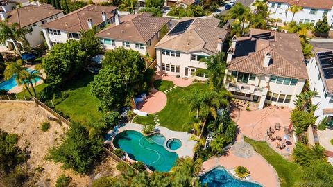 Welcome to this perfectly situated Canyon Rim home with endless views in the gated community of Santa Barbara. Featuring 6 bedrooms, 4.5 bathrooms large loft area, laundry upstairs and ensuite bedroom downstairs. The backyard is an entertainers dream...
