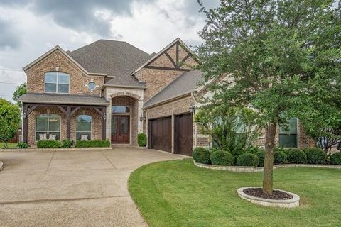 STUNNING home in sought after Flower Mound on OVERSIZED lot! Features handscraped hardwoods,soaring ceilings,natural light,cascading staircase & fabulous layout. Beautiful island kitchen is a chef's delight with custom cabinets, granite CTs, SS appli...