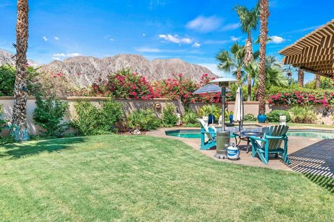 Are you a boating enthusiast that would like to have access to this community's private 23-acre lake in the desert? Welcome to Lake La Quinta! This 3-bedroom home has an open floor plan with cathedral ceilings that create an inviting space for entert...