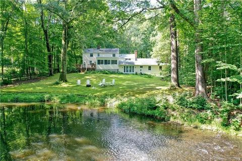 Relax and reflect along the serene Silvermine River in this New Canaan gem. Whether perched on the rolling lawn, or gazing out of the wide wall of windows, the river's rhythm sets the tone for this 3400sf colonial. The open plan living room is highli...